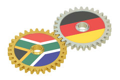 South Africa and Germany flags on a gears, 3D rendering. Isolated on white background Royalty Free Stock Images