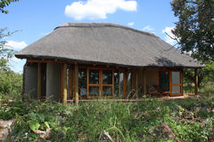 South Africa Hut. Safari hut in south Africa with clouds in background Royalty Free Stock Images