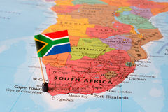 South Africa map and flag pin. Paper flag pin on a map of the Republic of South Africa, exotic travel concept, legislative capital Cape Town royalty free stock photography