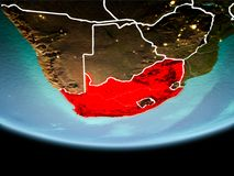 South Africa in red in the evening. Country of South Africa in red on planet Earth in the evening with visible border lines and city lights. 3D illustration stock images