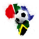 South Africa soccer world cup. Soccer ball on south African grunge painted flag Royalty Free Stock Image