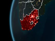 South Africa from space at night. Orbit view of South Africa highlighted in red with visible borderlines and city lights on planet Earth at night. 3D Stock Photography