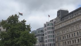 South Africa and UK flags. A building with waving  .London 2017 stock video footage