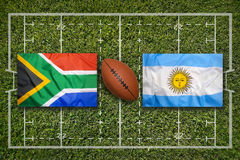 South Africa vs. Argentina flags on rugby field Stock Photo