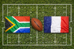 South Africa vs. France flags on rugby field Royalty Free Stock Image