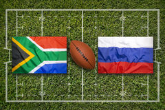 South Africa vs. Russia flags on rugby field. South Africa vs. Russia flags on green rugby field Stock Photography