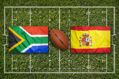 South Africa vs. Spain flags on rugby field. South Africa vs. Spain flags on green rugby field Stock Image