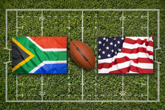 South Africa vs. USA flags on rugby field. South Africa vs. USA flags on green rugby field Royalty Free Stock Images