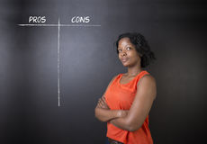South African or African American woman teacher or businesswoman pros and cons decision list Royalty Free Stock Images
