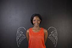 South African or African American woman teacher or student angel with chalk wings Royalty Free Stock Photos