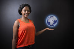 South African or African American woman teacher or student holding world earth globe Stock Photos