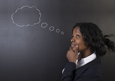 South African or African American woman teacher or student thinking cloud Stock Photos