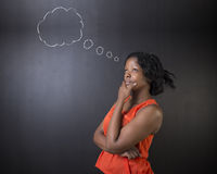 South African or African American woman teacher or student thinking cloud royalty free stock photos