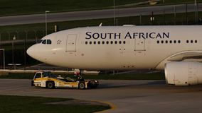 South African Airways plane on taxiway, close-up view. South African jet doing taxi in Munich Airport, MUC stock video footage