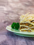 South African bobotie dish layered with pancakes. Traditional South African main course bobotie, served as lunch by making layers with pancakes Royalty Free Stock Images