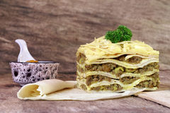 South African bobotie dish layered with pancakes. Traditional South African bobotie dish layered with pancakes and served for lunch Royalty Free Stock Photos