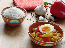 South African curry with vegetables, fruit and eggs. Traditional South African curry with vegetables and dried apples, served with boiled eggs and white rice Royalty Free Stock Photography