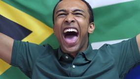 South African Fan celebrates holding the flag of South Africa in Slow Motion. High quality stock photos