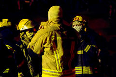 South African Firefighters in full bunker gear at night Stock Photo
