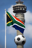 South African Flag and 2010 Football World Cup ico. The South African flag set against a blue sky and a giant soccer ball mounted on the Johannesburg iconic royalty free stock photos