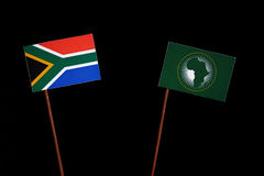 South African flag with African Union flag isolated on black. Background royalty free stock photography