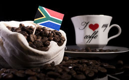 South African flag in a bag with coffee beans isolated on black. Background royalty free stock photography