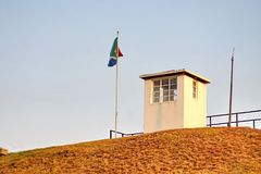 South African flag on Constitution Hill in Pretoria. South African flag flying by the old prison museum on Constitution Hill, Pretoria, South Africa royalty free stock images