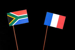 South African flag with French flag on black. Background royalty free stock photos
