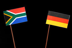 South African flag with German flag isolated on black. Background stock photography