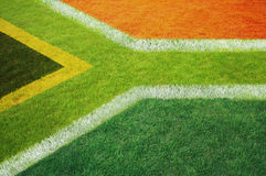 South African flag marked on grass pitch Stock Image