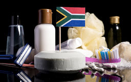 South African flag in the soap with all the products for the peo. Ple hygiene royalty free stock photo