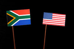 South African flag with USA flag on black stock image