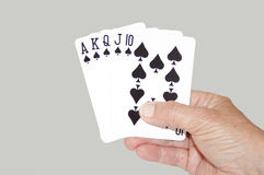 Isolated Hand Held Royal Flush Of Spades Stock Images