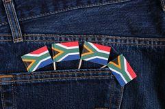 South African Flags. Small South African flags in the pocket of denim trousers stock image