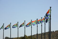 South African Flags. Ten South African flags flying in a moderate breeze royalty free stock image