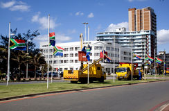 South African Flags Being Erected At Half-Mast. DURBAN, SOUTH AFRICA - DECEMBER 6, 2013: Municipal employees erecting South African flags at half-mast in honor royalty free stock photo