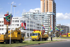 South African Flags Being Erected At Half-Mast. DURBAN, SOUTH AFRICA - DECEMBER 6, 2013: Municipal employees erecting South African flags at half-mast in honor stock image