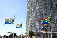 South African Flags Flying At Half-Mast. DURBAN, SOUTH AFRICA - DECEMBER 6, 2013: South African flags flying at half-mast in honor of Nelson Mandela in Durban royalty free stock photo
