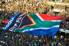 South African Flags at a Rugby game. JOHANNESBURG, SOUTH AFRICA - AUGUST 21: The South African flag at the FNB Stadium in Soweto on August 21, 2010.  The game Royalty Free Stock Photos