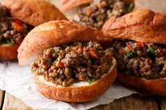 South African food: deep-fried vetkoek sandwich with meat curry Royalty Free Stock Photo