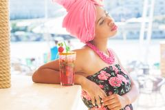 South african girl is drinking cocktail mojito in Royalty Free Stock Images