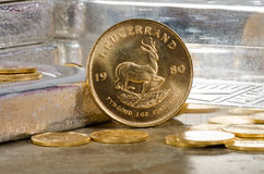 South African Gold Coin with Silver Bars Royalty Free Stock Photo