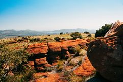 South African Magaliesberg plateau on a sunny day, red rocks. A group of fantastically nature shaped yellow rocks in the South African Magaliesberg plateau on a Stock Photo