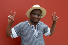 South African man with victory sign hands Stock Photography