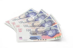 South African money. South African one hundred notes spread out. White background royalty free stock image