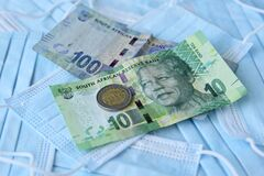 South African money on top of medical face masks
