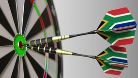 South African national achievement. Flags of the SAR on darts hitting bullseye. Conceptual 3D rendering. Canadian national achievement. Flags of Canada on darts royalty free stock photos