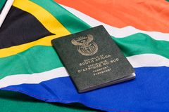 South African passports on flag. South African passport on SA flag royalty free stock photography