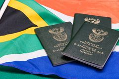 South African passports on flag stock image