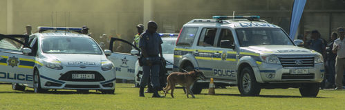 South African Police K9 Unit inspecting vehicles Stock Images